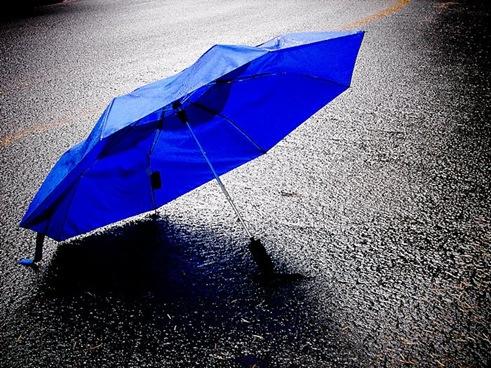 blue-umbrella-in-the-rain