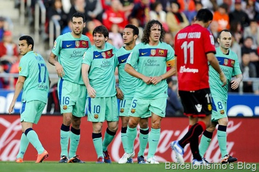 FC Barcelona players celebrate after scoring the opening goal during the La Liga match between RCD Mallorca and FC Barcelona at Iberostar Stadium on March 24, 2012 in Mallorca, Spain.
